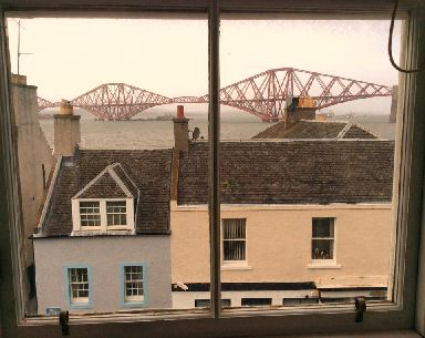 The Forth Rail Bridge and South Queensferry rooftops.