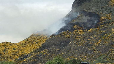 Arthur's Seat: Smoke can be seen rising from the hill.