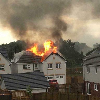 Roof ablaze: Crews battling the fire.