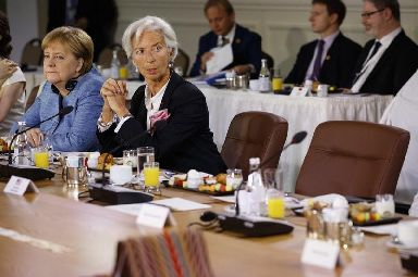 Mrs Merkel and the IMF's Christine Lagarde wait patiently for Mr Trump.