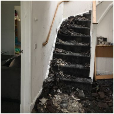Ruined: Inside house after fire.