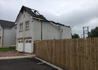 Destroyed: Roof was struck by lightning.