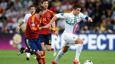 Cristiano Ronaldo takes on Spanish defenders at Euro 2012.