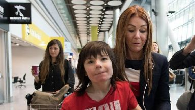 Charlotte Caldwell and her son Billy at Heathrow Airport.