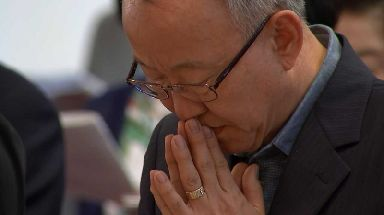 A member of Seoul's Anglican cathedral praying for peace and unity.