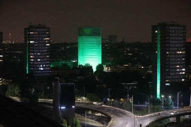 Grenfell Tower was illuminated in green last night to mark a year since the tragedy.