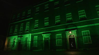 Downing Street in London is illuminated in green to mark a year since the Grenfell tragedy.