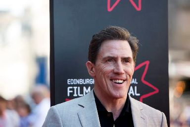 Rob Brydon plays Eric in Swimming With Men