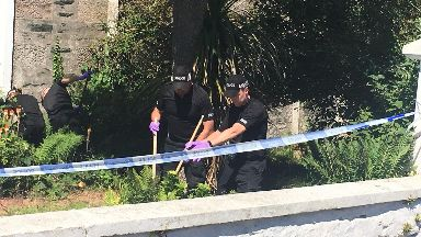 Bute: Police searched gardens for evidence.