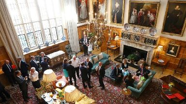 Members of the Cabinet mingle at Chequers