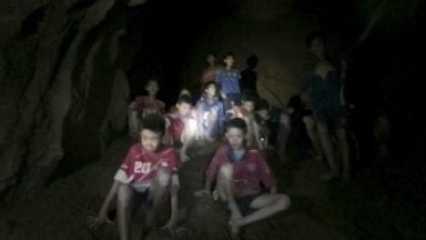 Cave: Boys slowly being rescued.