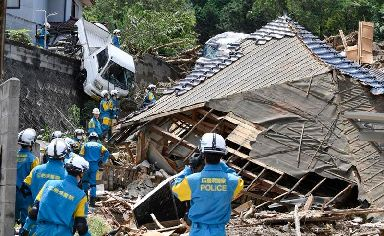 Rescuers prepare to start a search for missing people at the site of a landslide in Kumano town, Hiroshima prefecture