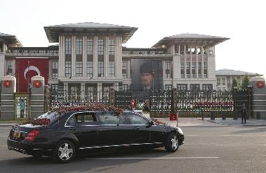 Turkey's President Recep Tayyip Erdogan is driven to a ceremony at the Presidential Palace