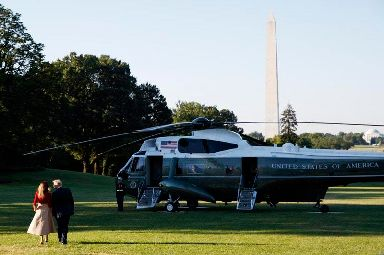 First lady Melania Trump and President Donald Trump board Marine One on the South Lawn of the White House