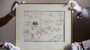 An original illustrated map of Winnie-The-Pooh's Hundred Acre Wood has sold for a record £430,000.