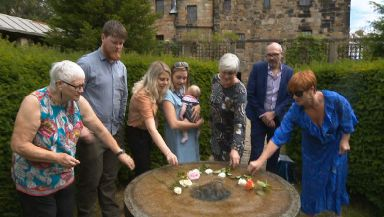 Families gathered at a memorial in Glasgow in July.