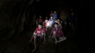 The boys and their coach as they were found in a partially flooded cave Thailand