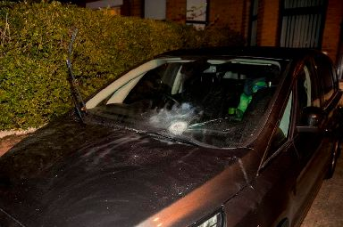 Damage to a car at the scene in West Belfast