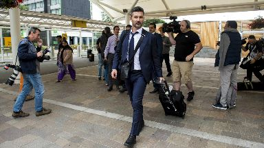 Landed: Marinos Ouzounidis in Glasgow ahead of his first competitive game in charge.