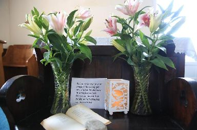 A prayer and floral tribute at the Mission Church of St Peter the Fisherman in Staithes