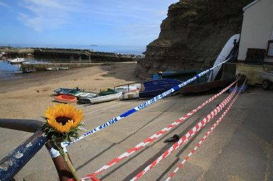 Police tape near the beach at Seaton Garth