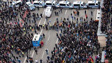 Police separate leftist and nationalist demonstrators in Chemnitz.