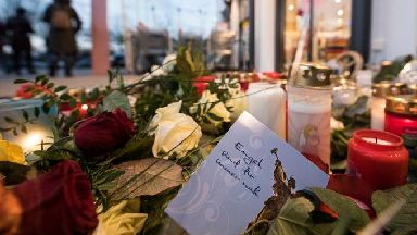 Tributes at the site where the 15-year-old was stabbed.