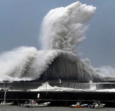 High waves hit breakwaters at the port of Aki