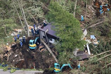 Police search for missing people at the site of a landslide after an earthquake in Atsuma town, Hokkaido
