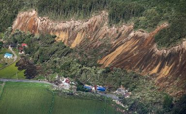 Houses are destroyed by a landslide after an earthquake in Atsuma town, Hokkaido, northern Japan