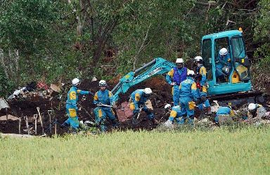 Rescuers at the site of a landslide in Atsuma town