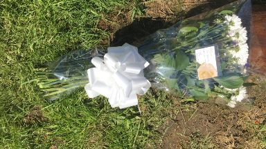 Tributes: Flowers were put down in memory of him.