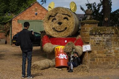 A Winnie the Pooh scarecrow charms visitors to the annual Harpole Scarecrow Festival