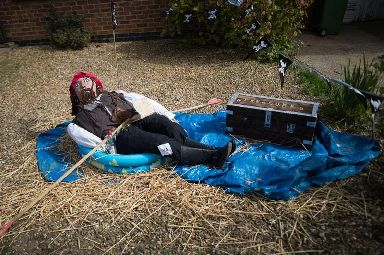 A Captain Jack Sparrow scarecrow is all at sea in a paddling pool