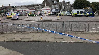 Cordon: Police have closed off roads.