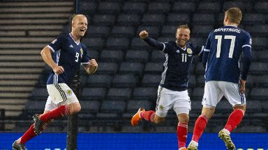 Scotland's Steven Naismith (left) wheels away after scoring the second.