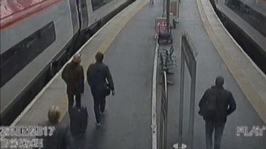 Caught on camera: The armed robbers travelled back to London by train.