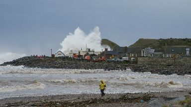 Flood: A wave overtopping during coastal storms at Stonehaven.