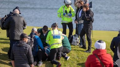 Injured: The woman was treated on the course by paramedics.