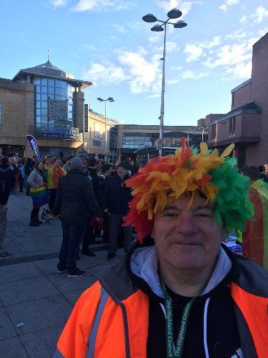 Pride: Marcher in colourful wig.