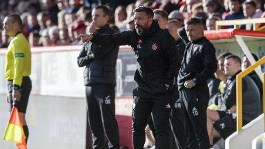 Pleased: Derek McInnes watched his team cruise to victory over St Mirren.