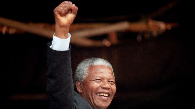 Politics: Nelson Mandela salutes the crowd in George Square, Glasgow.