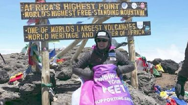 Corinne Hutton at the Kilimanjaro summit, 2018