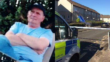 Scene: Kevin McGuire was injured outside his home in Wishaw.