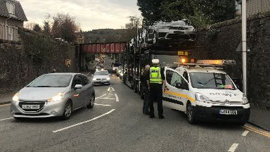 Crash: The lorry was towing Range Rovers and Jaguars.