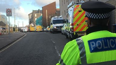 Dundee: Armed police called to siege.
