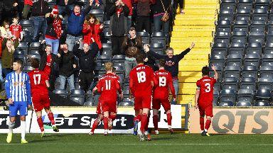 Lewis Ferguson celebrates after scoring to make it 2-1