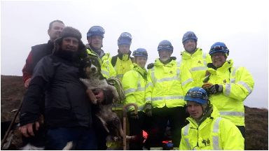 Rescued: Meg is pictured with her owner and rescuers.