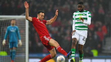 Challenge: Andy Considine looks to stop Celtic attacker Odsonne Edouard.