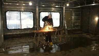 A welder at Ferguson Marine shipyard in Port Glasgow.